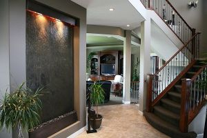 An-indoor-waterfall-wall-adds-to-the-style-quotient-of-the-home
