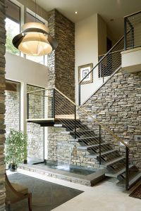 Contemporary-staircase-with-a-water-fetaure-underneath